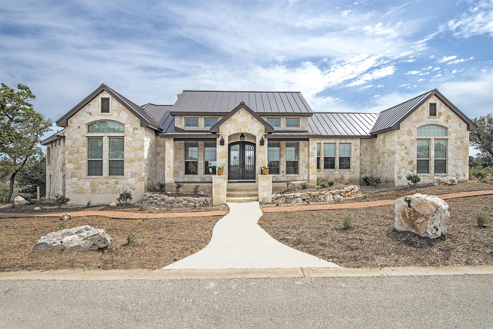 Front elevations custom home builder san antonio for Luxury home exterior