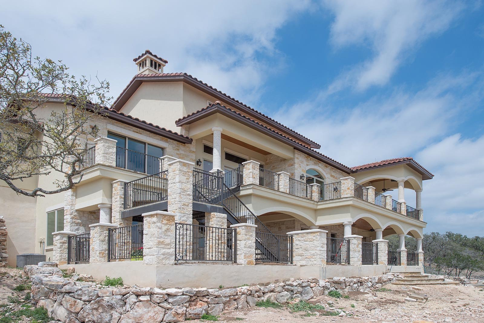 Luxury custom home texas hill country custom home for Hill country house plans luxury